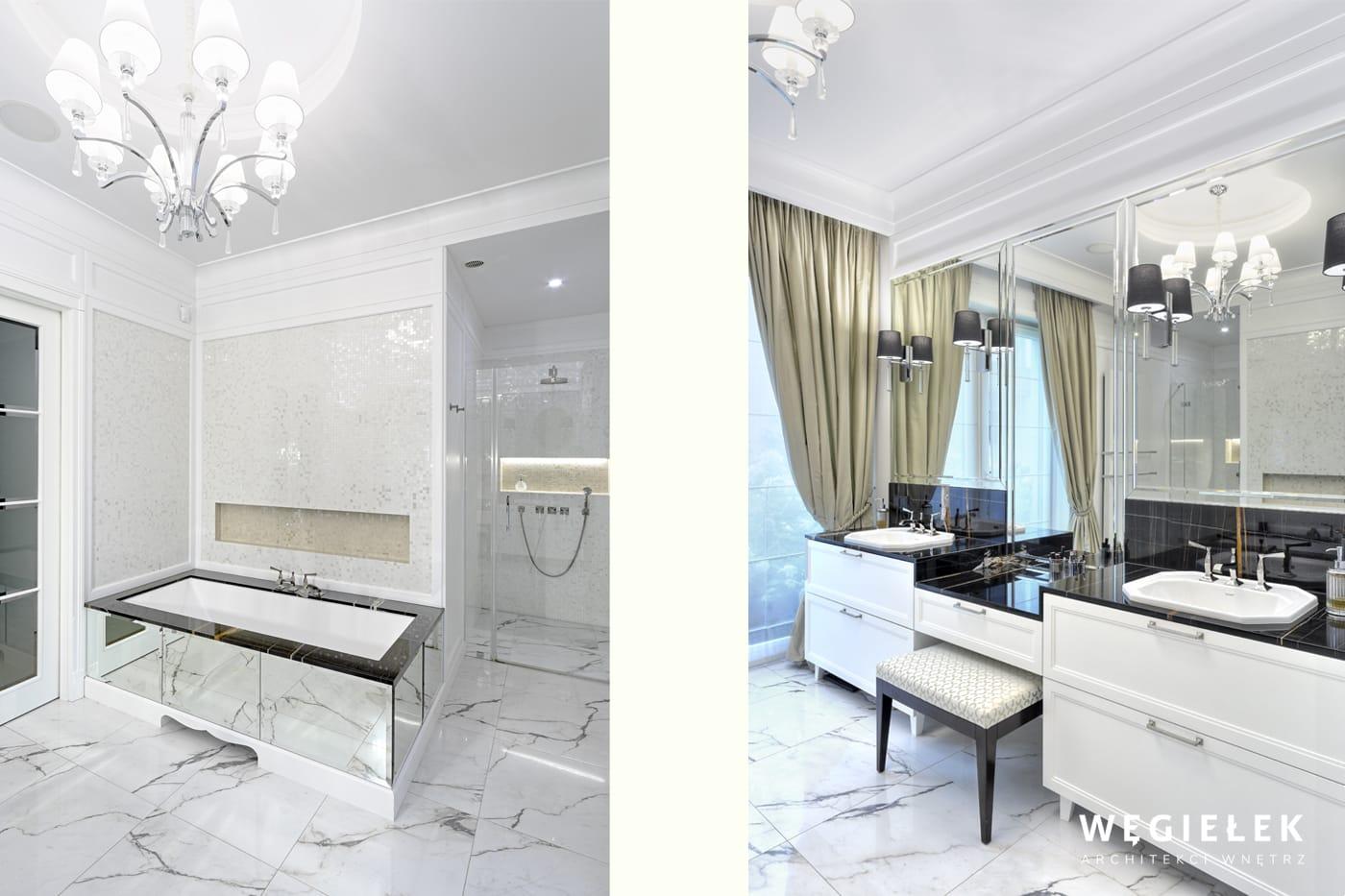 Architekt wnętrza zaprojektował przestronną łazienkę z dużą wanną i ogromnymi lustrami. Ciekawym rozwiązaniem jest połączenie jednym blatem umywalek i toaletki.