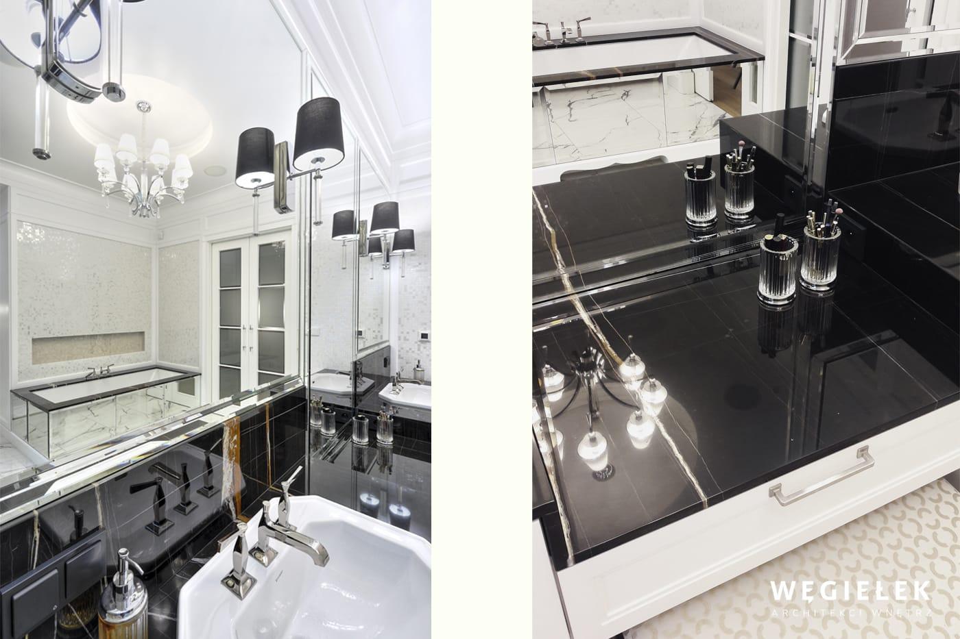 W tej łazience wszystko ma połysk, lustra, marmurowe blaty, podłoga, armatura. Projekt wnętrza zachwyca światłem i przestrzenią. Jest klasycznie piękny.